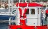 Djed Božićnjak doplovio brodom u Marinu Trogir